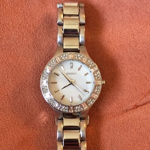 DKNY silver watch with silver pave face. NWOT